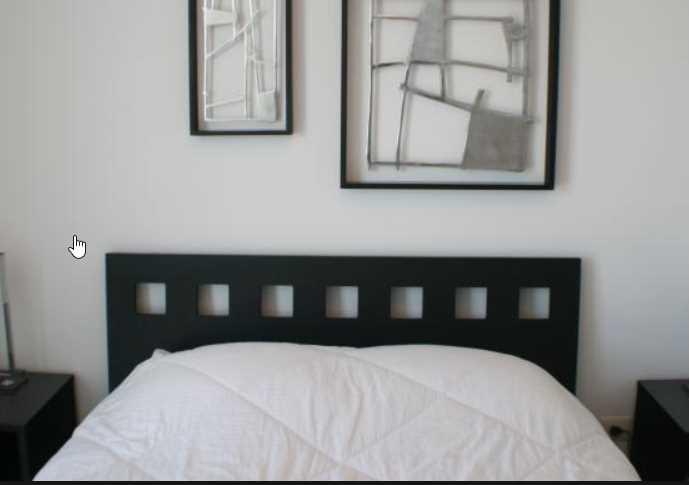 respaldos de cama oscuro de madera